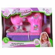 Roze speelgoed naaimachine